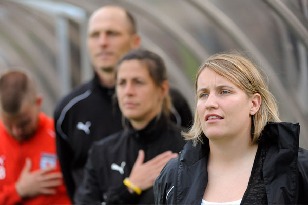 Red Stars coaching staff Emma Hayes, Denise Reddy and Nate Kip during the national anthem in 2009